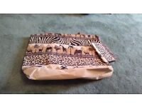 For sale we have a animal print canvas bag with purse