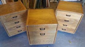 Two (2) 4 drawer oak finish side units and one (1) matching oak finish filing cabinet