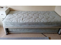 Single bed with folding guest bed underneath
