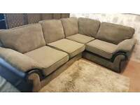 Black and mink grey fabric corner sofa. Delivery available