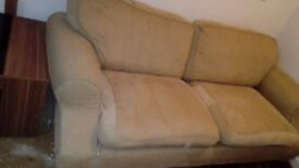 Large comfy 2 seater sofa free if collected now from menston..slight tear..nothing major