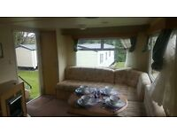 CHEAP starter holiday home for sale. On a beautiful 11 month holiday park!