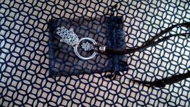 Hansa metal pendant on brown suede cord necklace