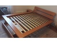 King size bed and matching bedside cabinet.