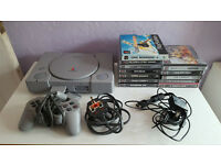 Sony PlayStation 1, PS1, with 12 games.