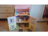 Le Toy Van dolls house complete with its starter furniture set