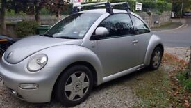 VW Beetle, Silver. Great little car.
