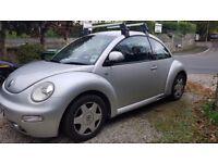 VW Beetle, Silver. Great little car.