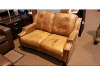 Italian soft tan leather 2 seater sofa with studs in great condition