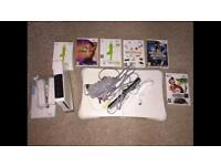 Nintendo Wii Bundle with Balance Board, Games, Controls and Manuals.