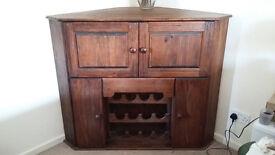 solid dark wood corner storage cupboard