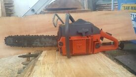 husquvarna 61 chain saw ***61cc engine ***very powerful and ready for work!!