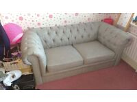 Silver grey material Chesterfield two seater sofa. Smoke free home.