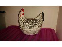 Ceramic hen for egg storage