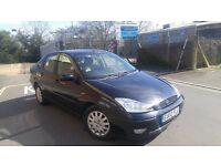 Ford Focus Ghia saloon 1.8 petrol Manual 12month MOT. Cheap good car. Ready to go.Black focus