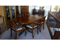 solid wood dining table, chairs and sideboard