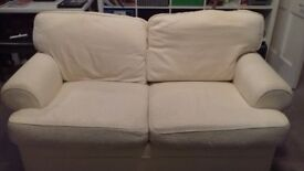 Cream sofa - 2 seater and armchair plus spare set of covers