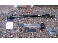 Gtech rechargeable hedge trimmer with branch cutter attachment.