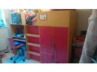 Pink wood cabin bed