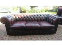 An ox blood red leather Chesterfield sofa in good condition