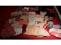 Lot of baby clothes. Many of them unused with tags still attached