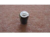 Reloadable heavy duty metal 35mm film cassette.