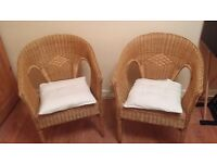 A pair of wicker chairs £25