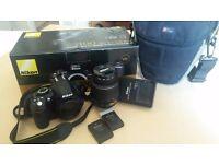 Nikon D3100 DSLR with 18-55mm f/3.5-5.6G VR Lens, UV Lens Filter, Case, 2x Batteries, Charger.