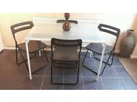 Ikea glass top table with 4 foldable chairs