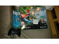 Wiiu black with extra Pro controller and 5 games