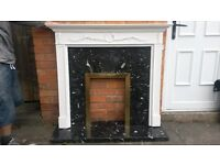 Fire surround with black marble backplate and hearth