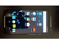 Moto G2 smartphone, 8GB memory, dual SIM slots, SD card slot, UNLOCKED