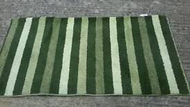 Green tri - coloured rug