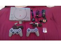 Sony PlayStation with two controllers and memory card