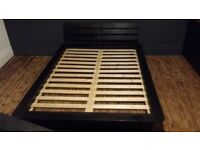 Double black wooden bed