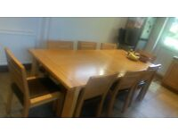Oak dining table and eight chairs