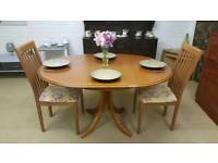 Round extending table and 2 chairs