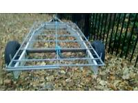 Transit roof rack with ladder roller