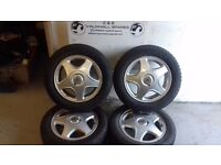 VAUXHALL 15 inch alloy wheels and tyres