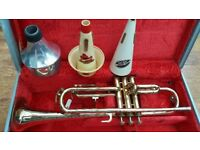 Corton Trumpet with Harmon Mute, Cup Mute and Straight Mute.