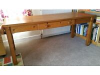 Large farmhouse style, pine kitchen table with a drawer.