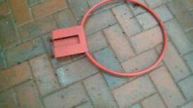 Red metal basketball/netball hoop.
