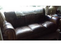 2 X good condition brown leather three seater sofas for sale