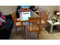SOLID WOOD TABLE WITH FROSTED GLASS & 6 CHAIRS IN GOOD CONDITION. STILL AVAILABLE