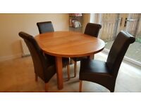 Extendable round dining table for sale