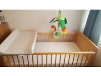 Cot bed with mattress, padded changing table and Fisher price rainforest mobile