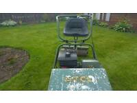 Atco sit on petrol lawn mower