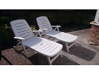 Two white sun loungers