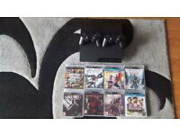 PS3 with 8 games & 2 controllers
