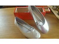 New silver ballet pumps
